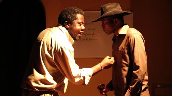 Bruce Makau right plays Kenyatta opposite Harry Ebale's Bildad Kaggia